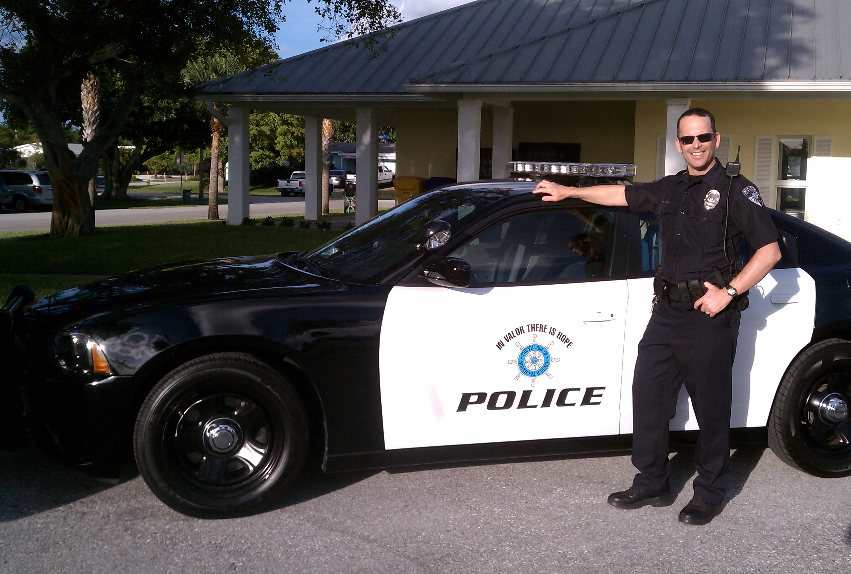 Captain William Minton Standing By His Police Cruiser