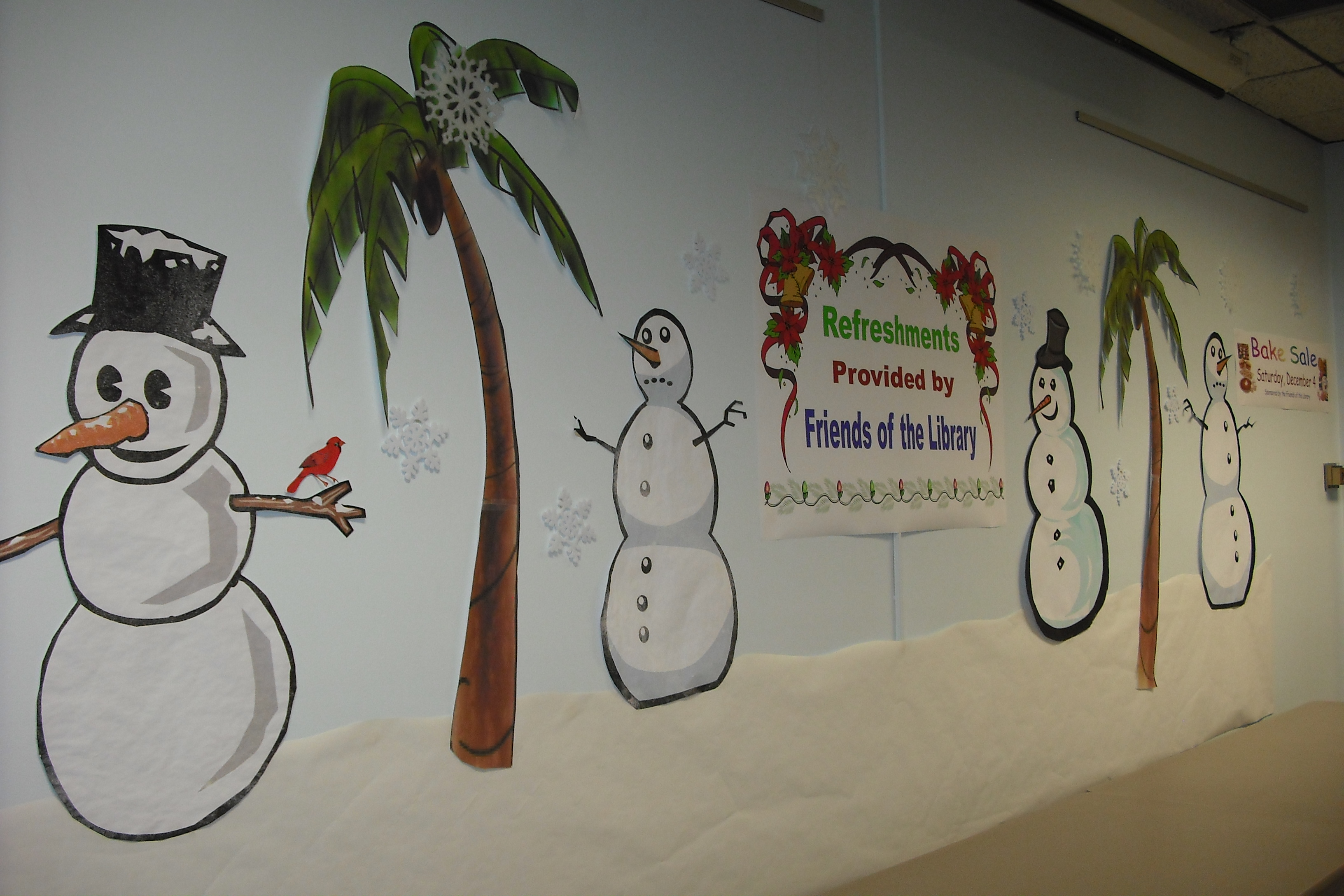 Snowmen and snow flakes decorate the interior of the library