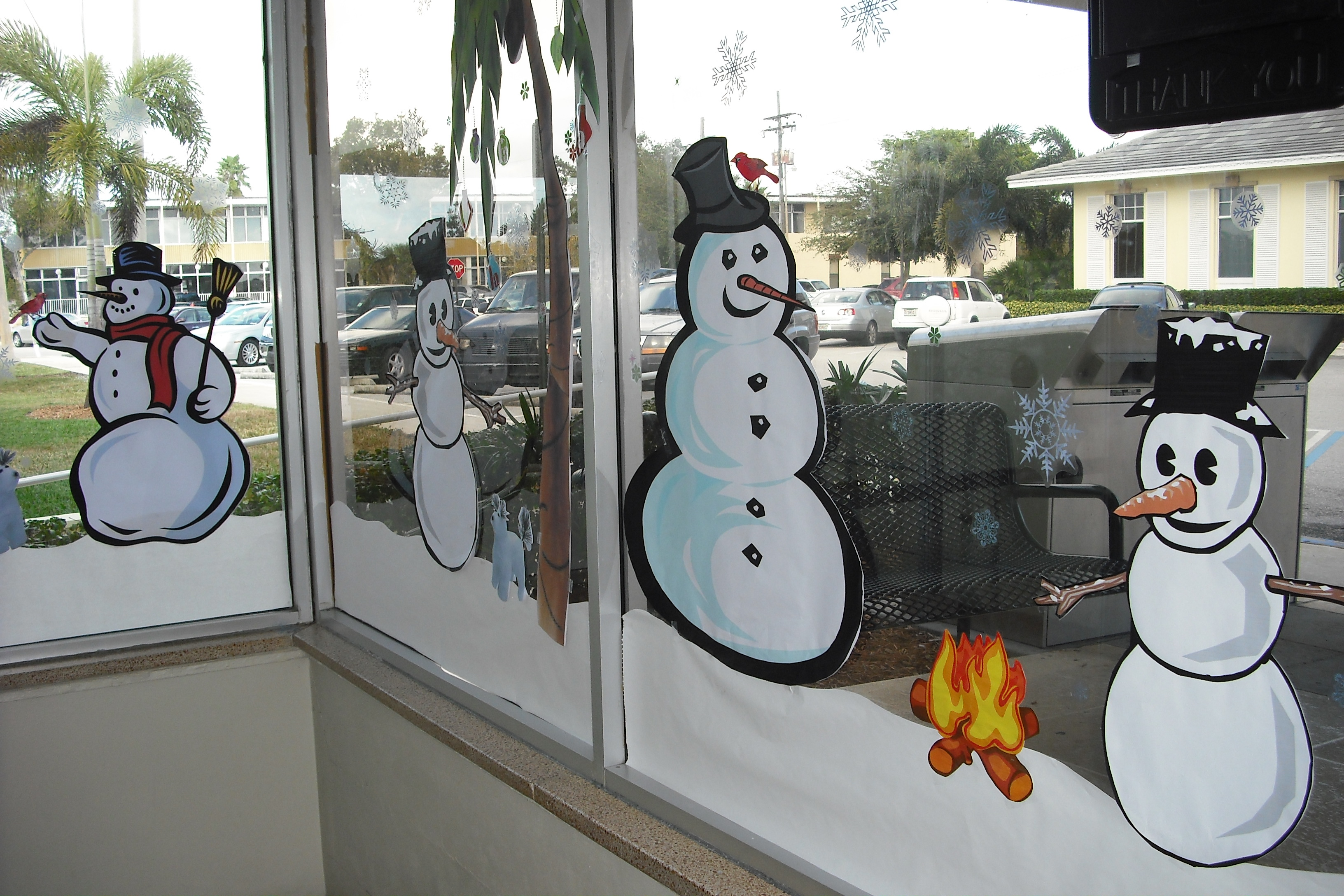 Snowmen and winter themes decorate the windows of the library
