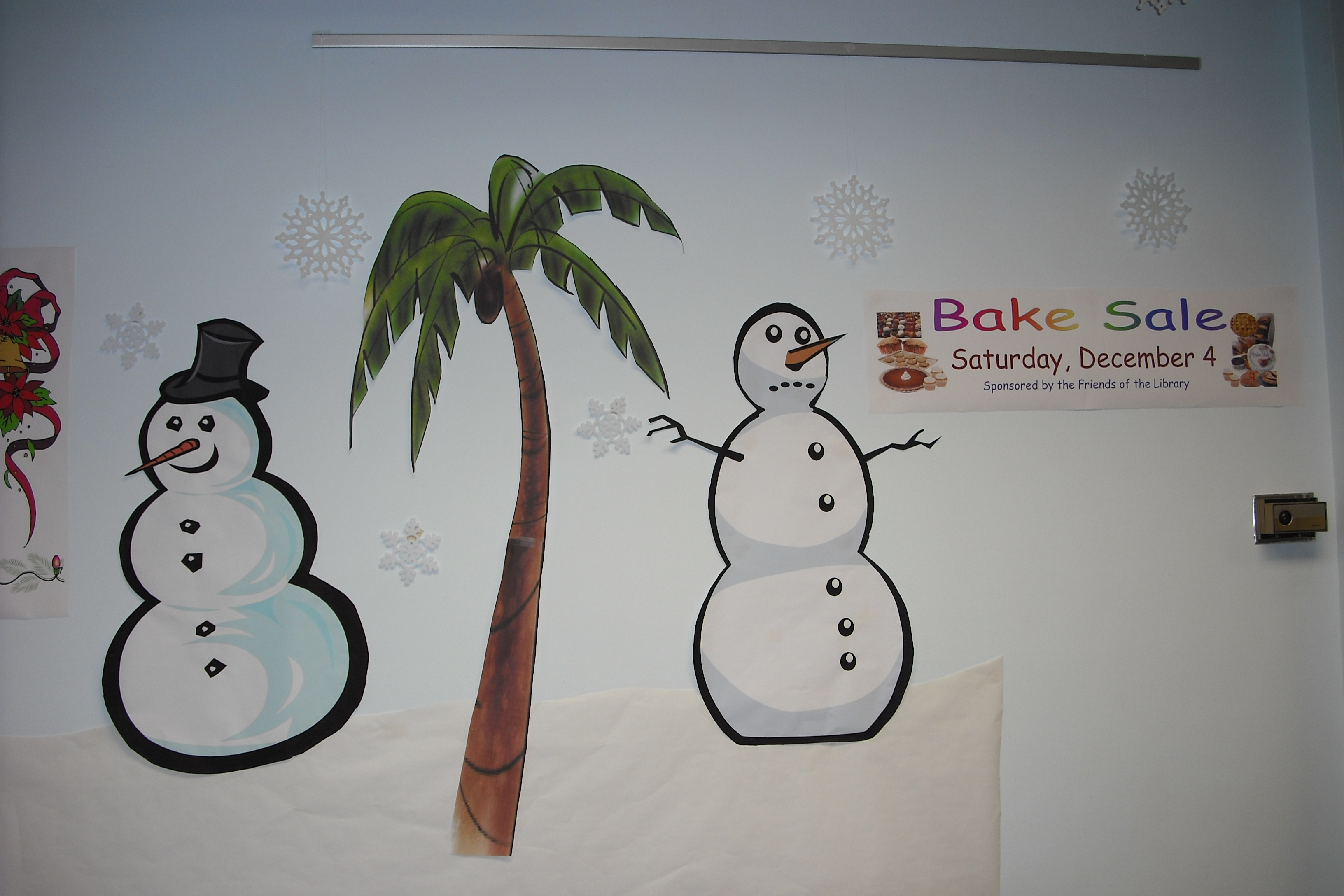 A snowman frowns at a bake sale poster