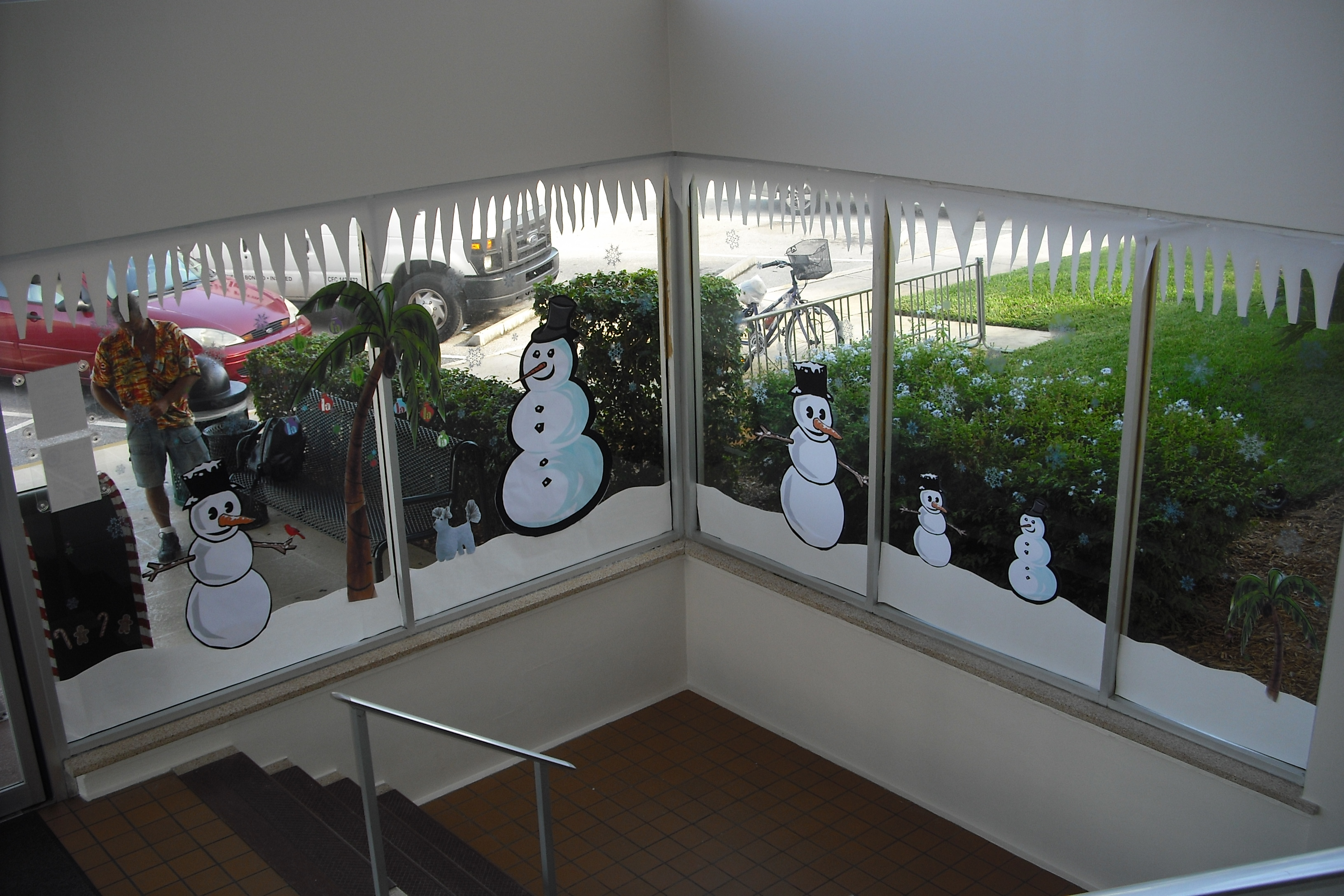 The snowmen decorations in the library look out to the warmer weather outside