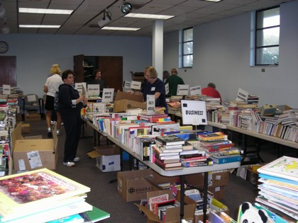 Volunteers are organizing the books on the display tables