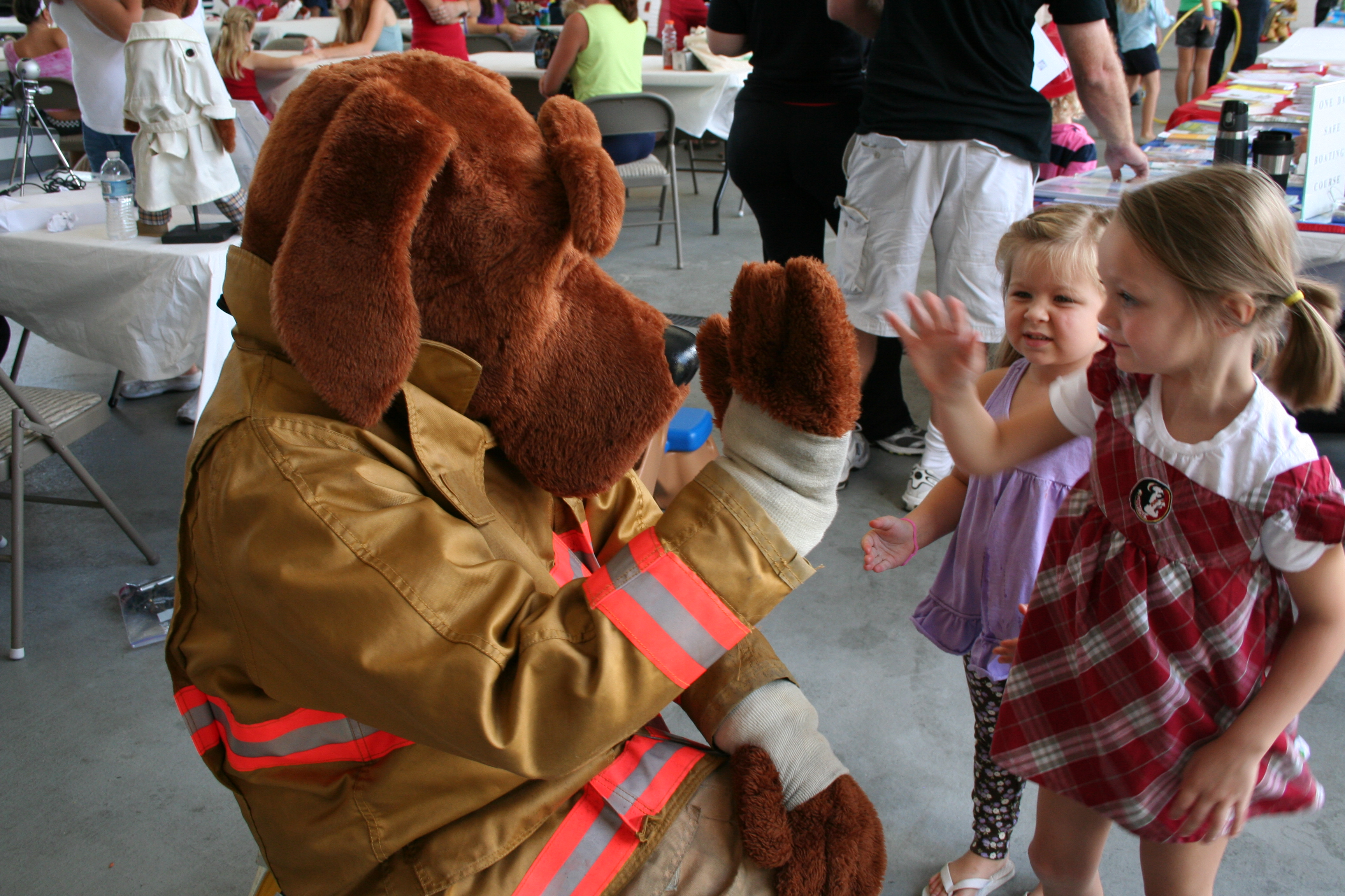 Fire Dog Mascot Gives Young Participants a High-5