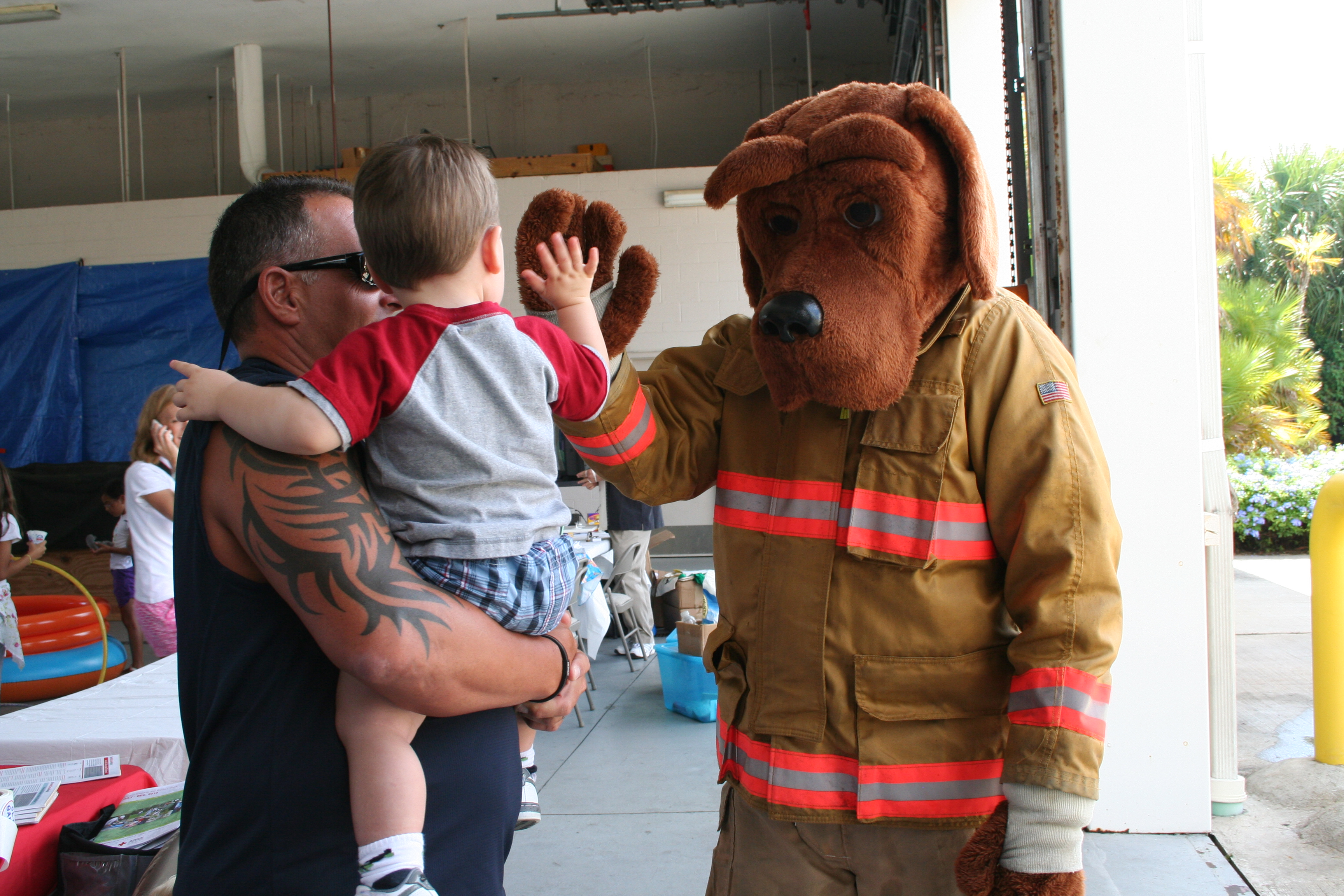 Fire Dog Mascot Greets Young Participant