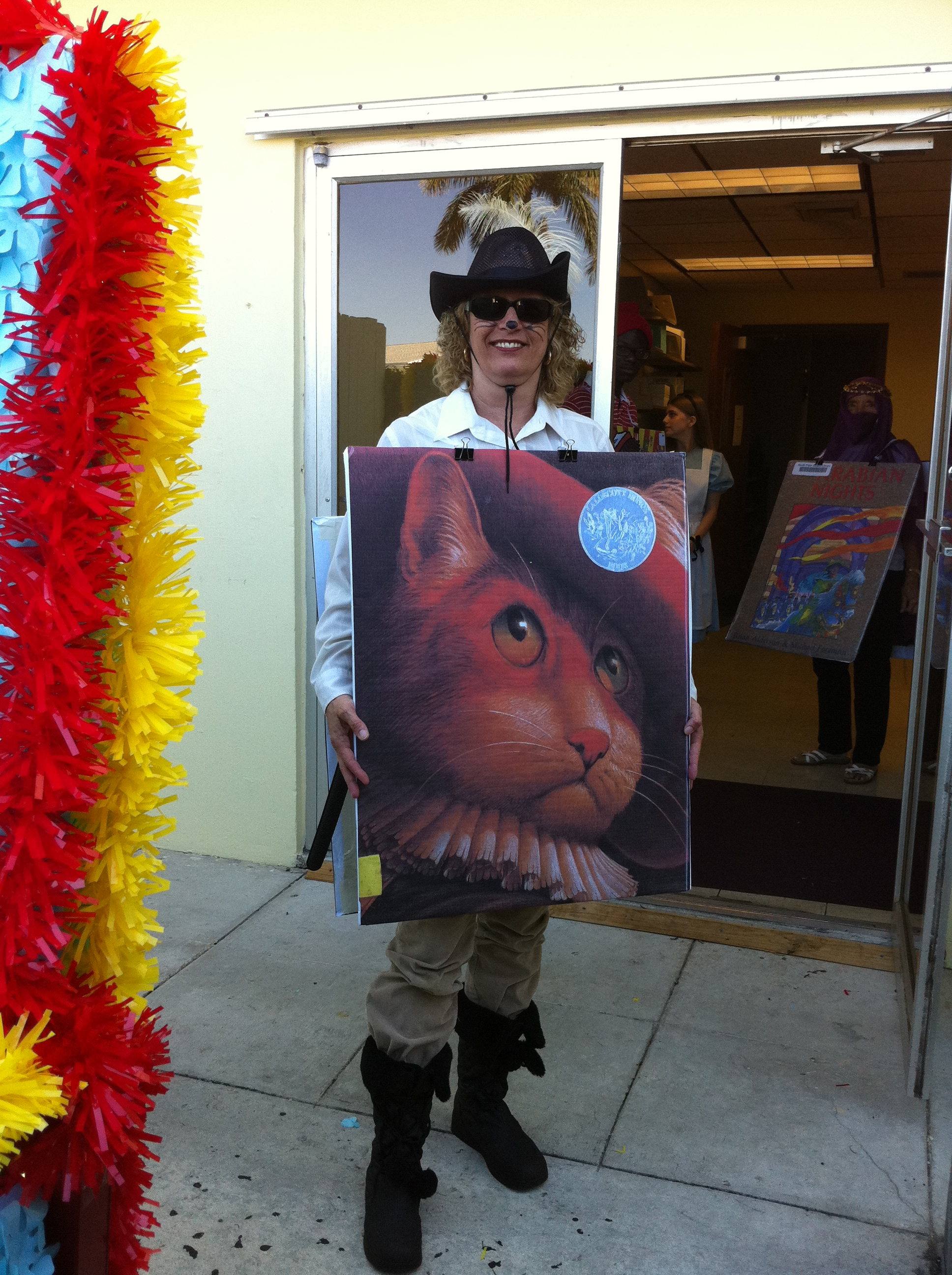 A parade participant dressed as a cat book