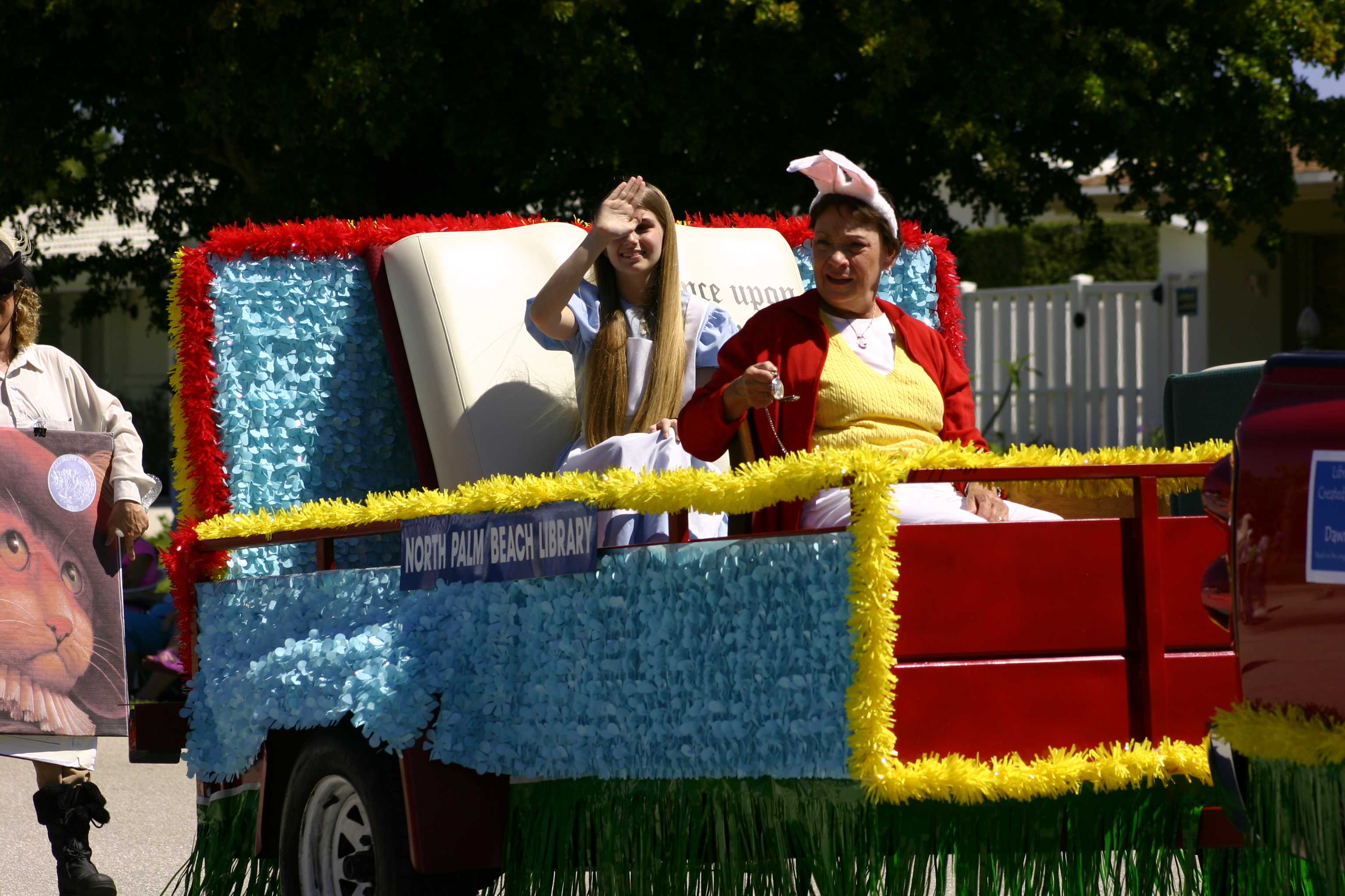 Alice and the White Rabbit sit on the Library's Float during the parade