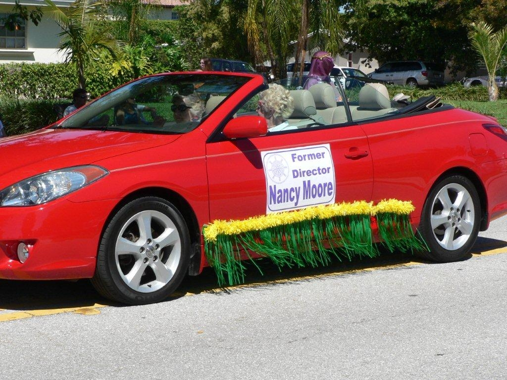 Former Director Nancy Moore drives her car during the parade
