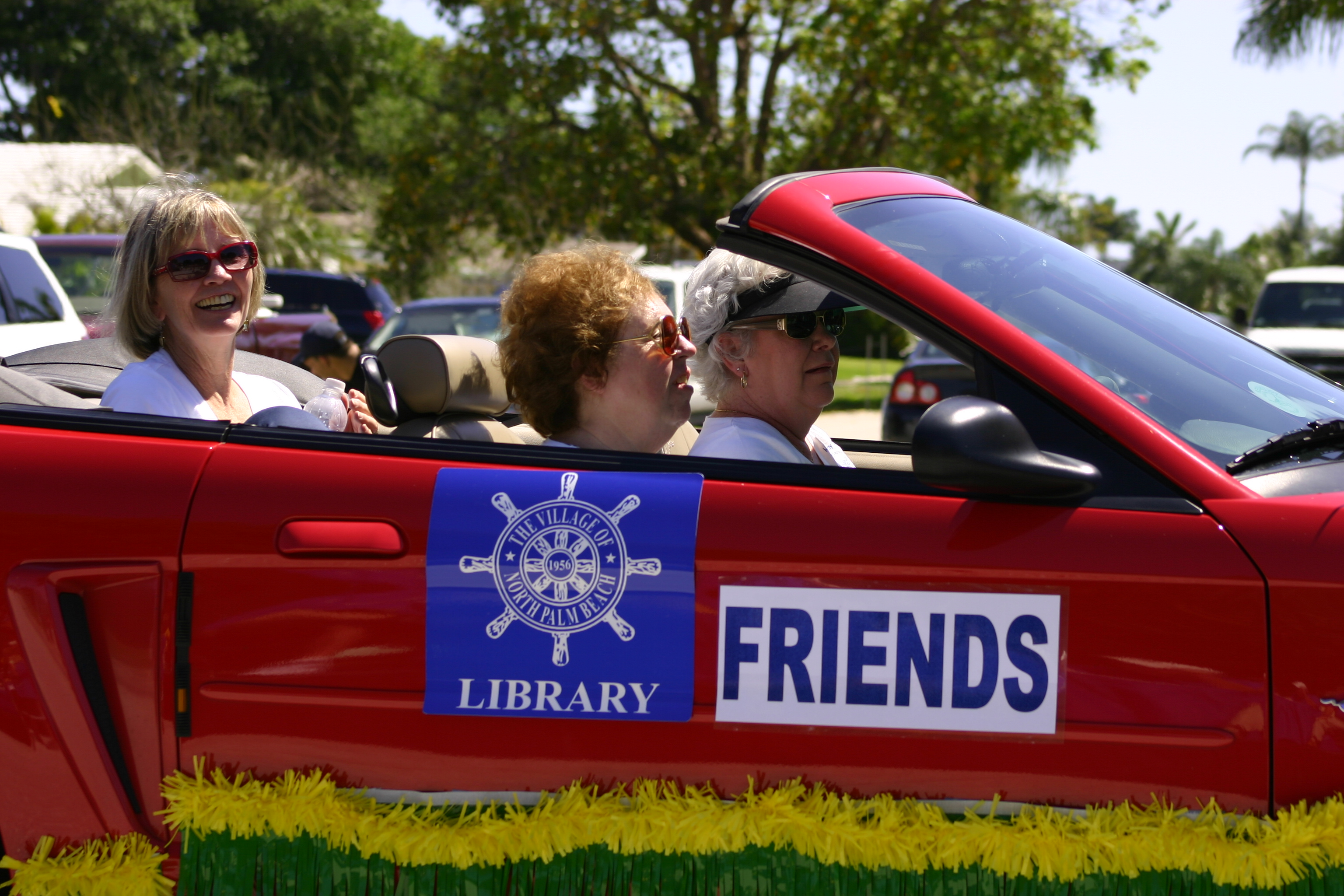 The Friends of the Library drive their hot-rod with the parade