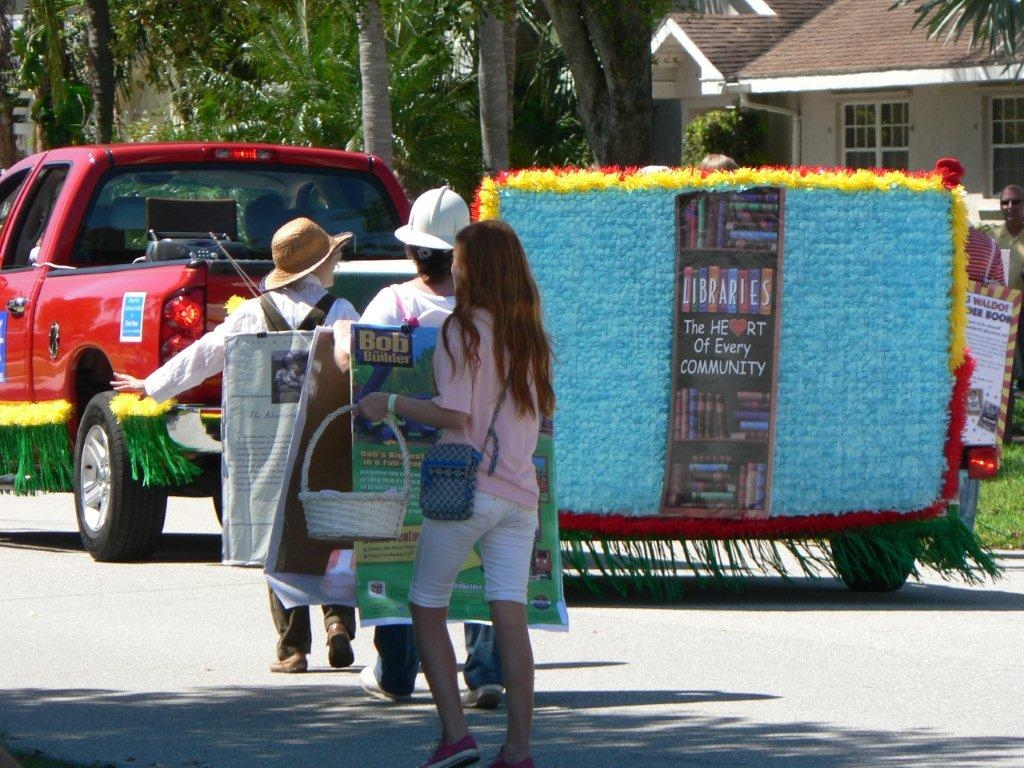 "The float has a sign saying, ""Libraries, the Heart of Every Community"""