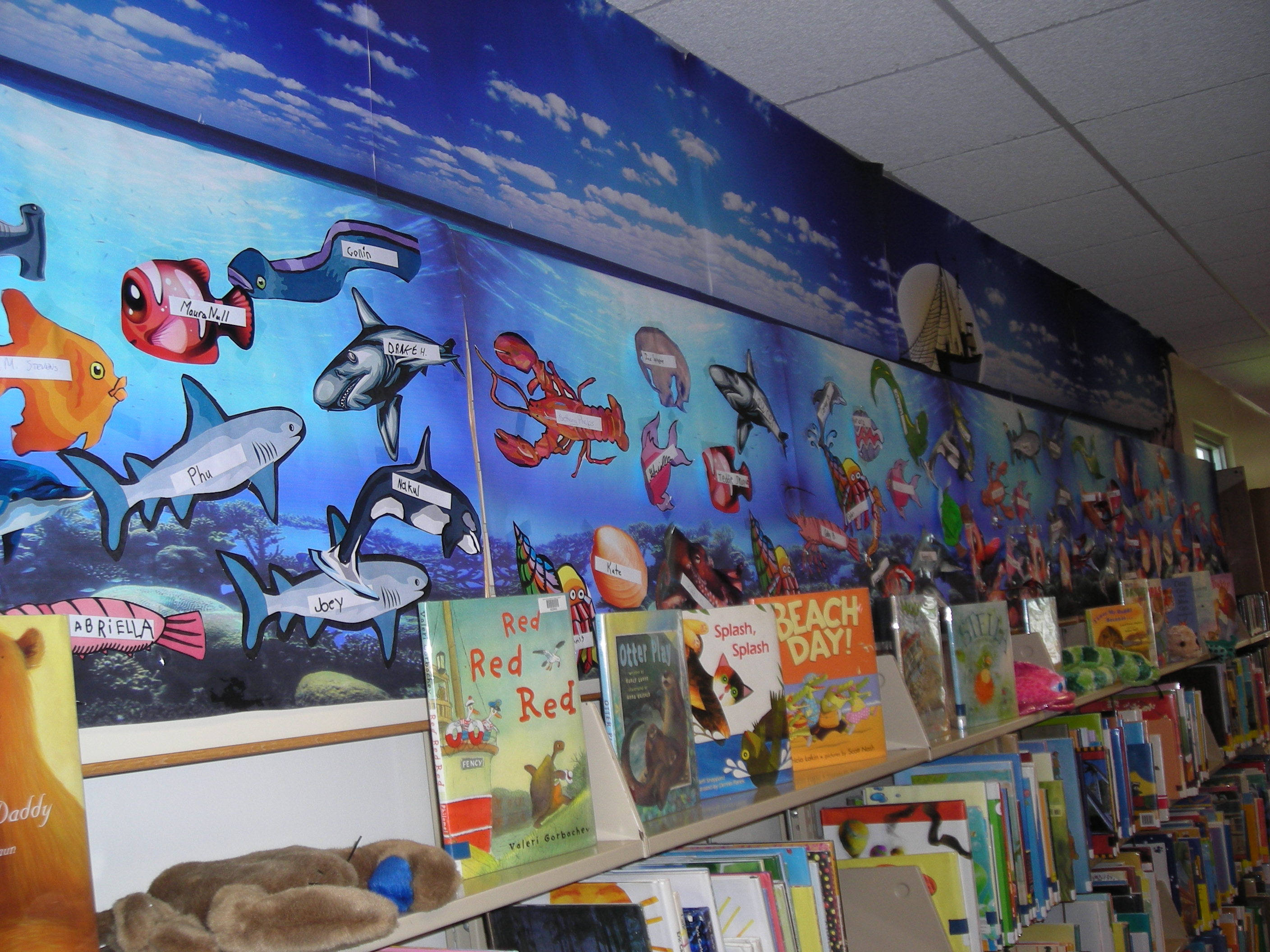 "A wall decorated with an ""under the sea"" theme"