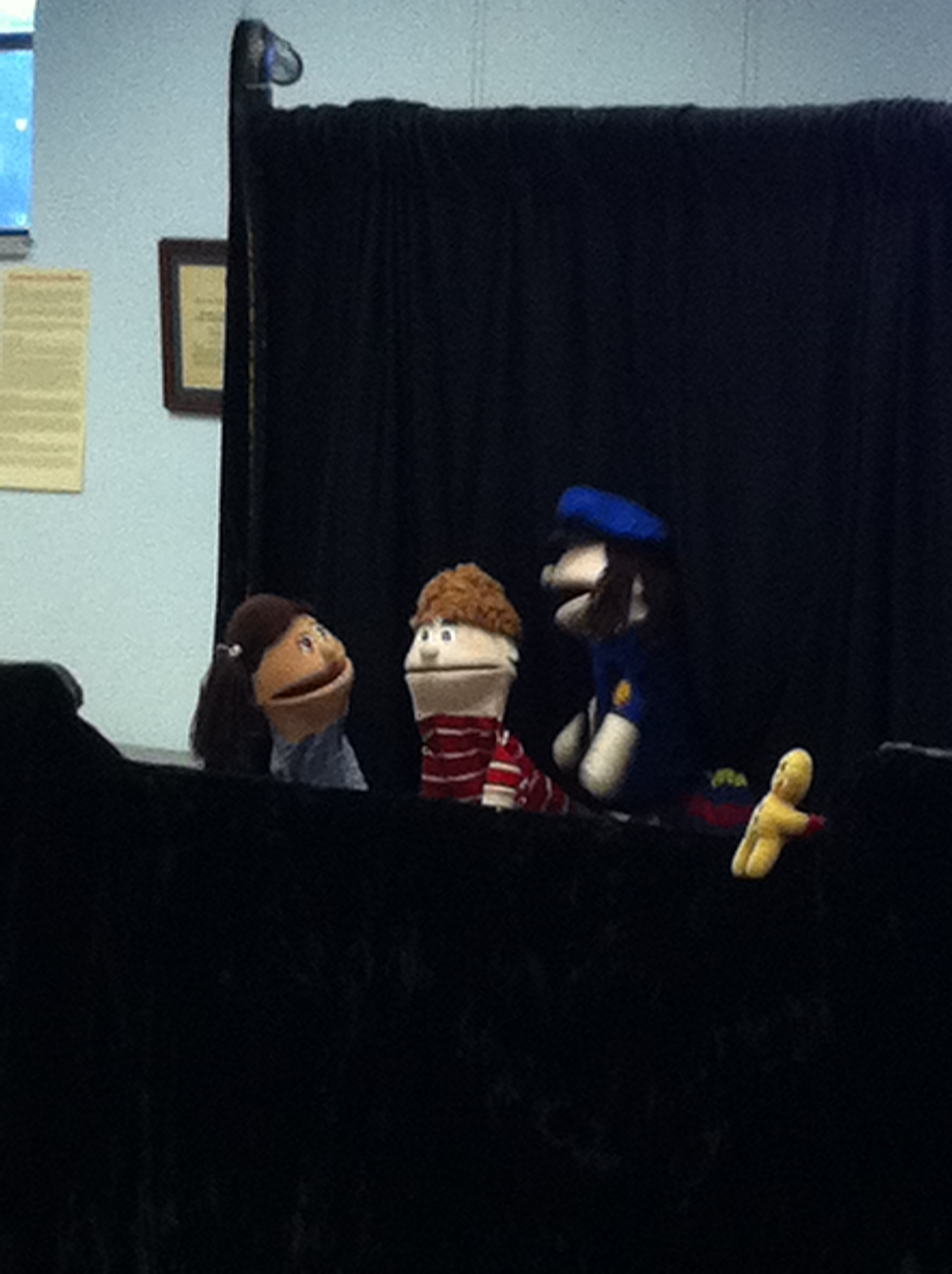 Puppets talk among themselves during the show