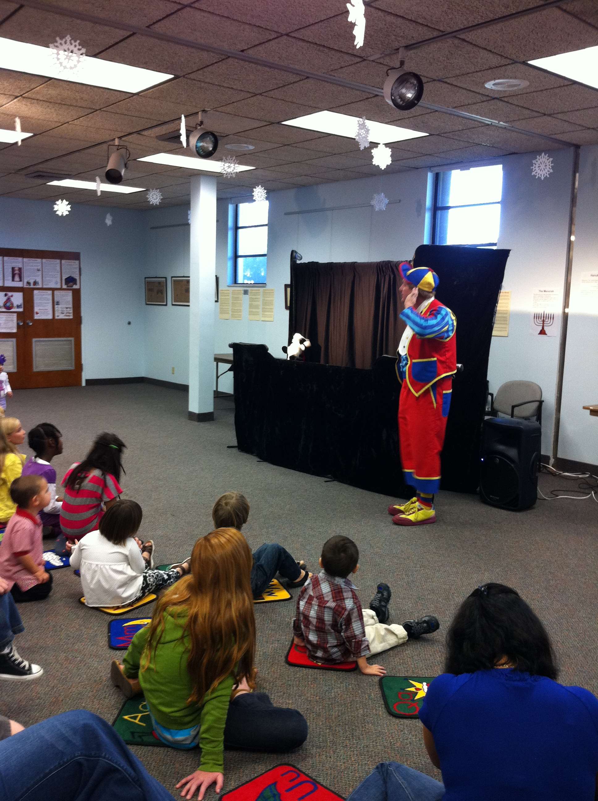 An actor sets the stage for a puppet show