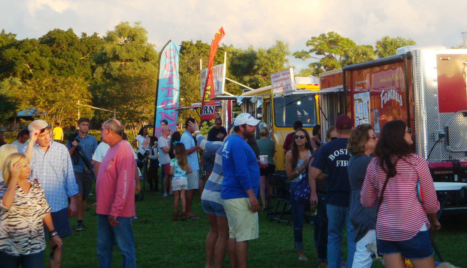 Crowd walking around food trucks