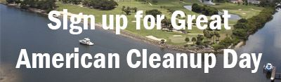 White text saying Sign up for Great American Cleanup Day over background aerial view of Village wate