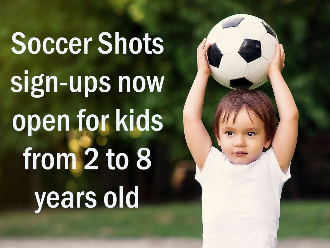 "Boy toddler holding soccer ball over his head, with text saying ""Soccer Shots sign-ups now open f"