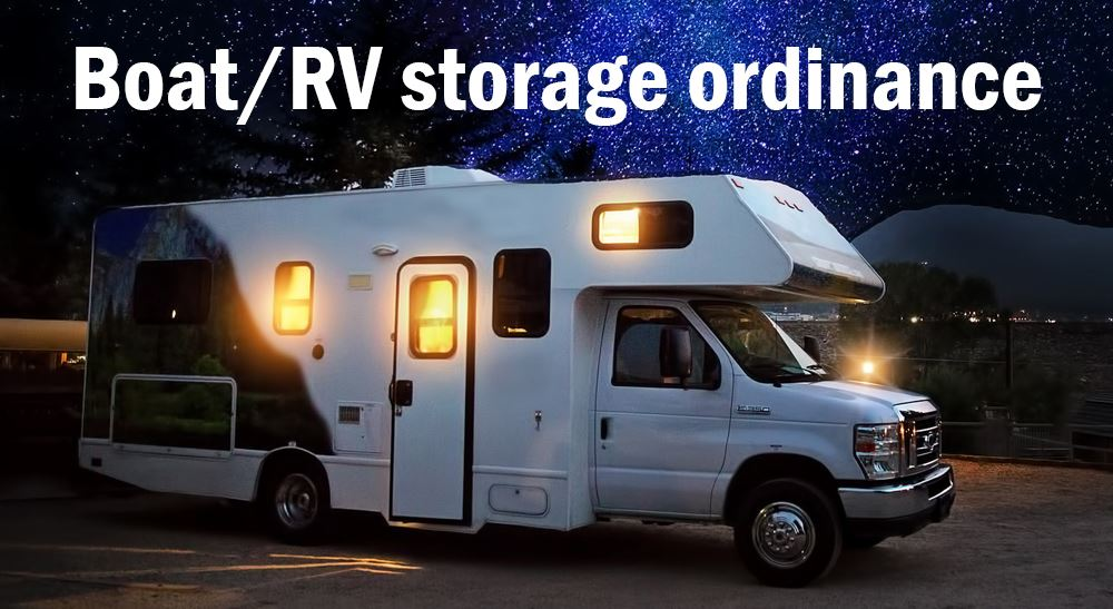 RV camping at night with text saying Boat RV ordinance