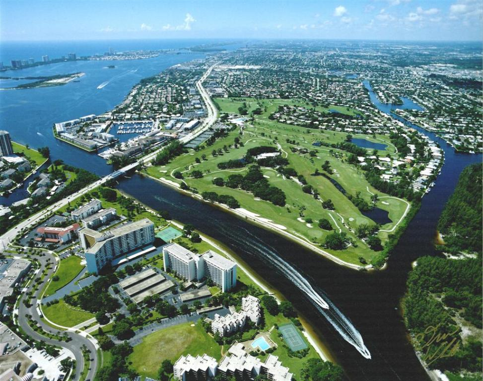 Aerial view of golf course with Intracoastal and North Palm Beach waterways, U.S 1 and Parker Bridge