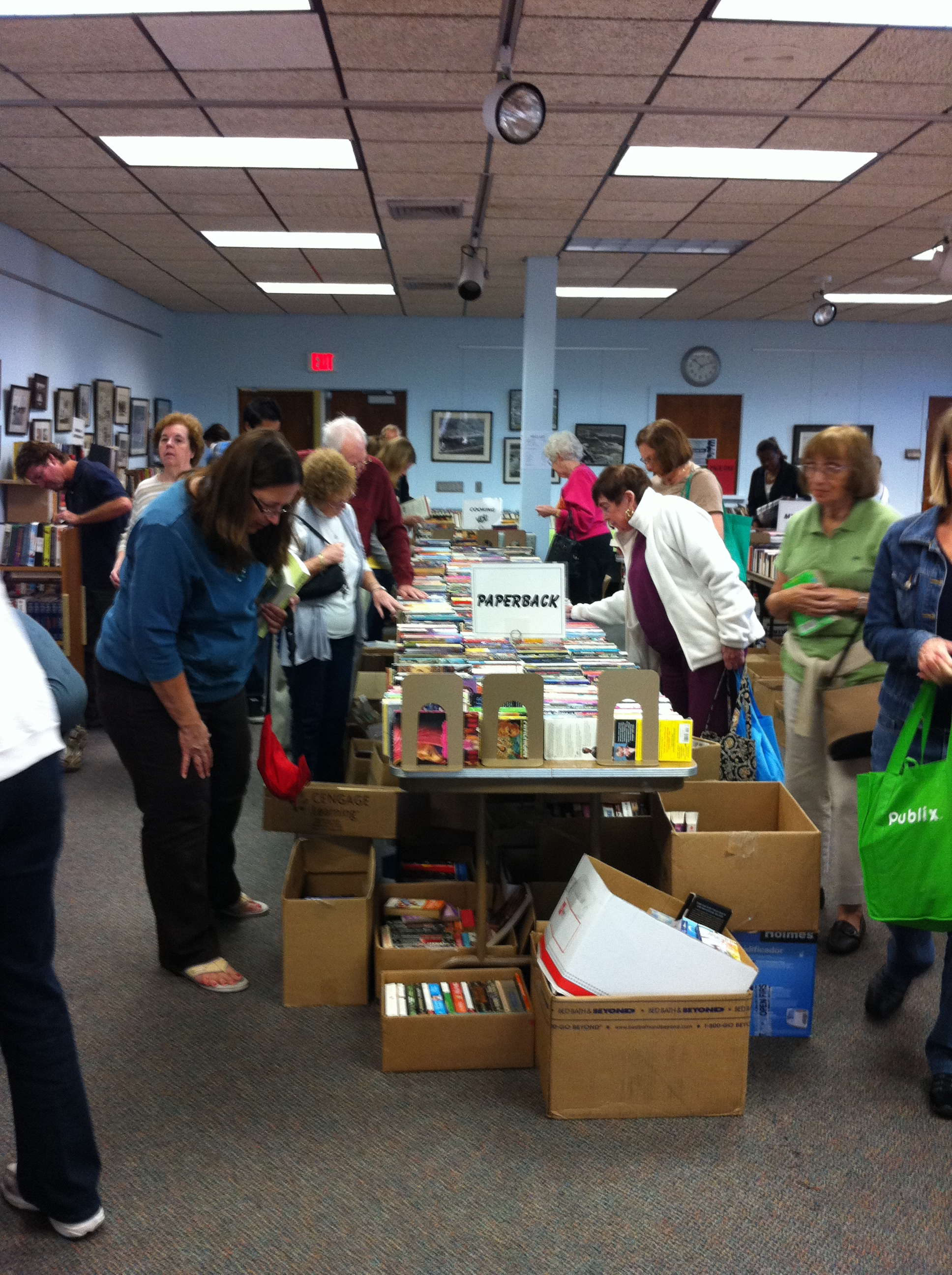 People search the book sale for a great read
